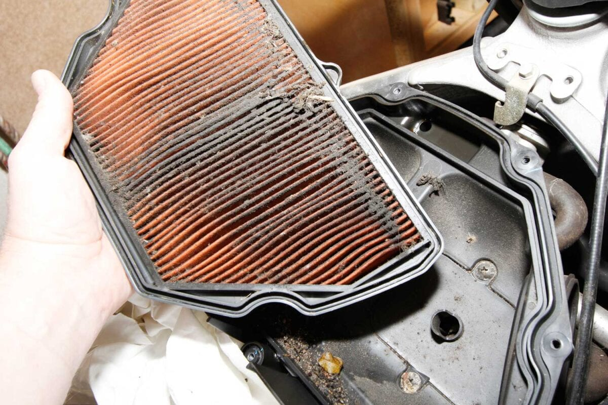 3: This is nasty. The filter's only just past its scheduled service, but it's packed with dead flies and road muck. Chuck it away, and carefully clean any rubbish out of the bottom of the air box.