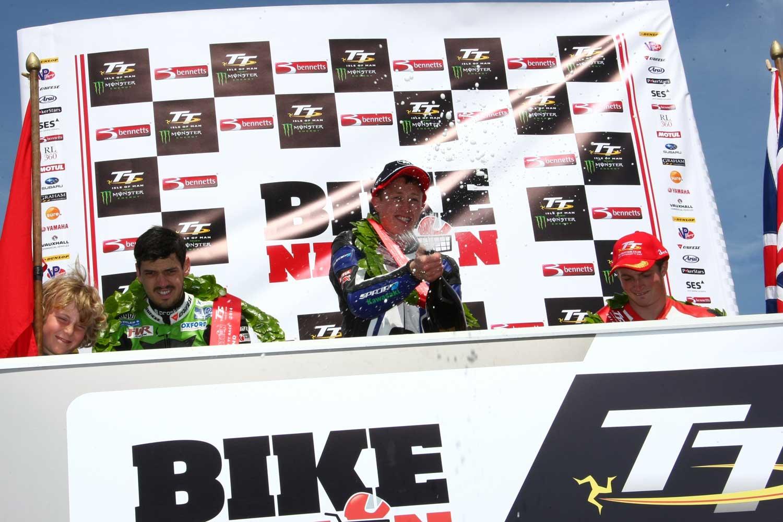 Dean Harrison celebrates after winning the 2014 Bikenation Lightweight TT. Image Double-Red