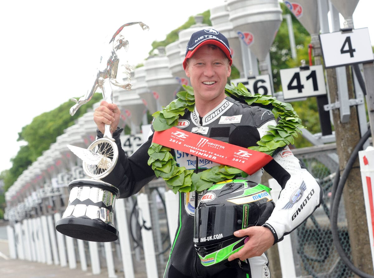 PACEMAKER BELFAST 02/06/2014: Gary Johnson (Smiths Triumph) celebrates after winning the Monster Energy Supersport race one  the race at the 2014 Isle of Man TT