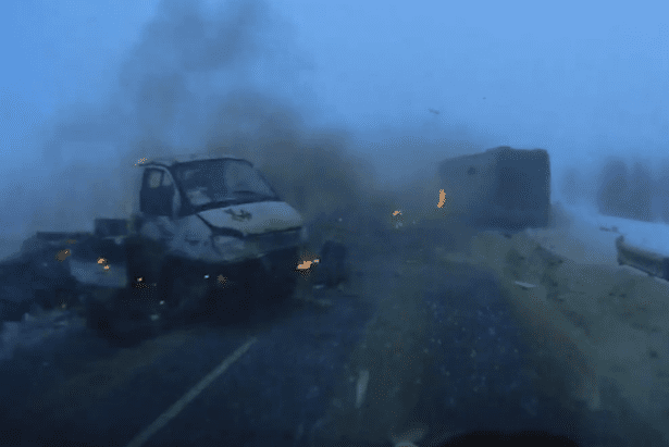 Driver-skims-through-the-middle-of-fireball-motorway-crash