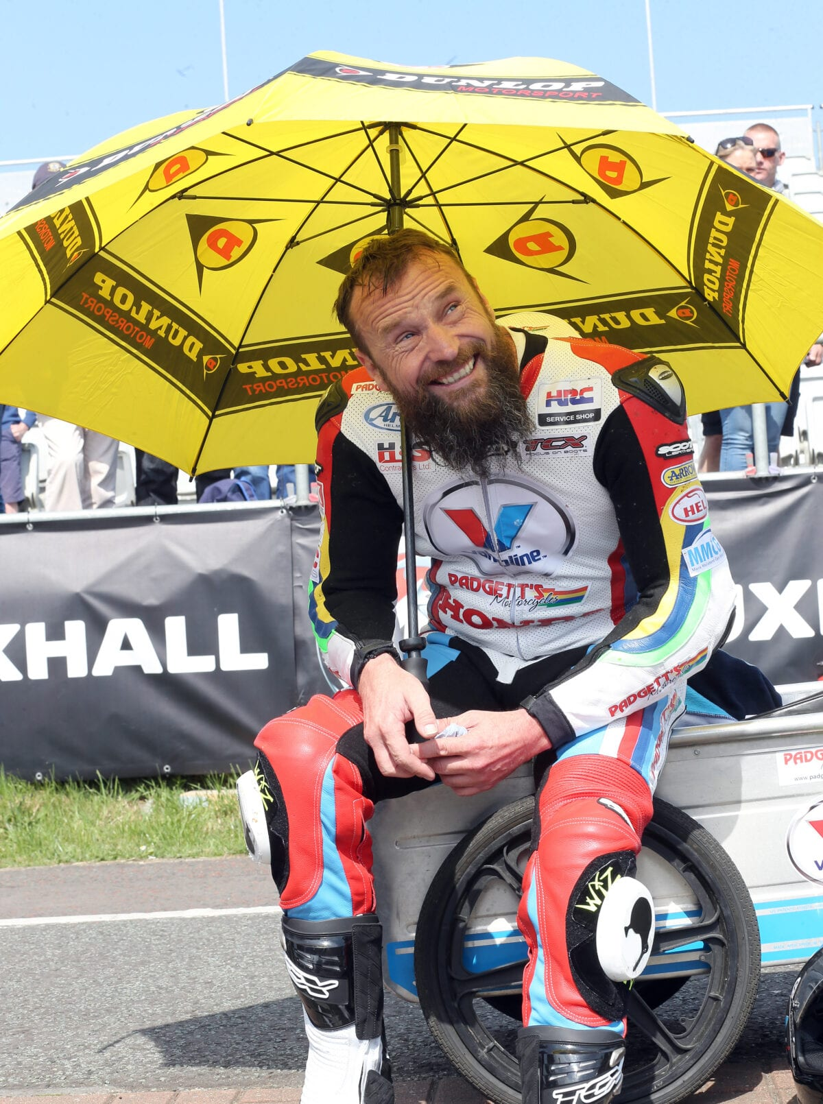 PACEMAKER, BELFAST, 10/5/2016: Bruce Anstey hides from the sun on the grid during the opening practice session for the Vauxhall International North West 200 today. PICTURE BY STEPHEN DAVISON