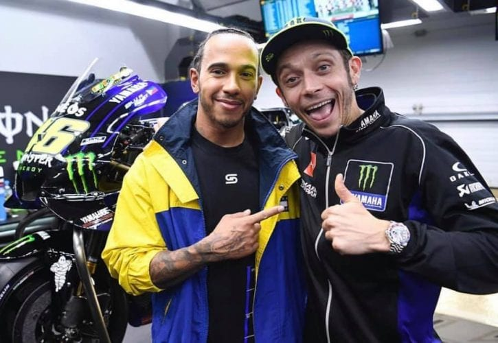 The guy on the left (Lewis Hamilton) is going to ride the guy on the right's (Valentino Rossi) factory Yamaha on December 9. And vice-versa (but swap the word Yamaha for Mercedes). At Valencia.