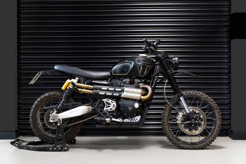 This is the Scrambler 1200 that James Bond rides up the side of an old castle in No Time To Die. Or it's one of the ones made for the new film, at least. Either way, it looks trick - very trick.