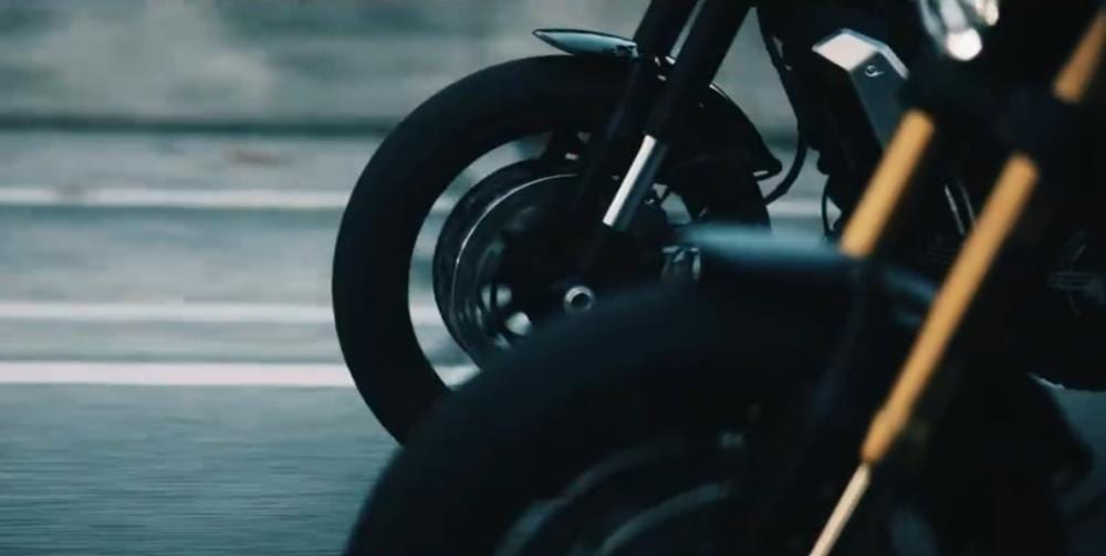 Two versions of the bike are seen riding side-by-side in the video.
