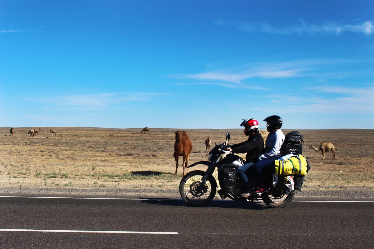 Photo of the pair motorcycling across the country