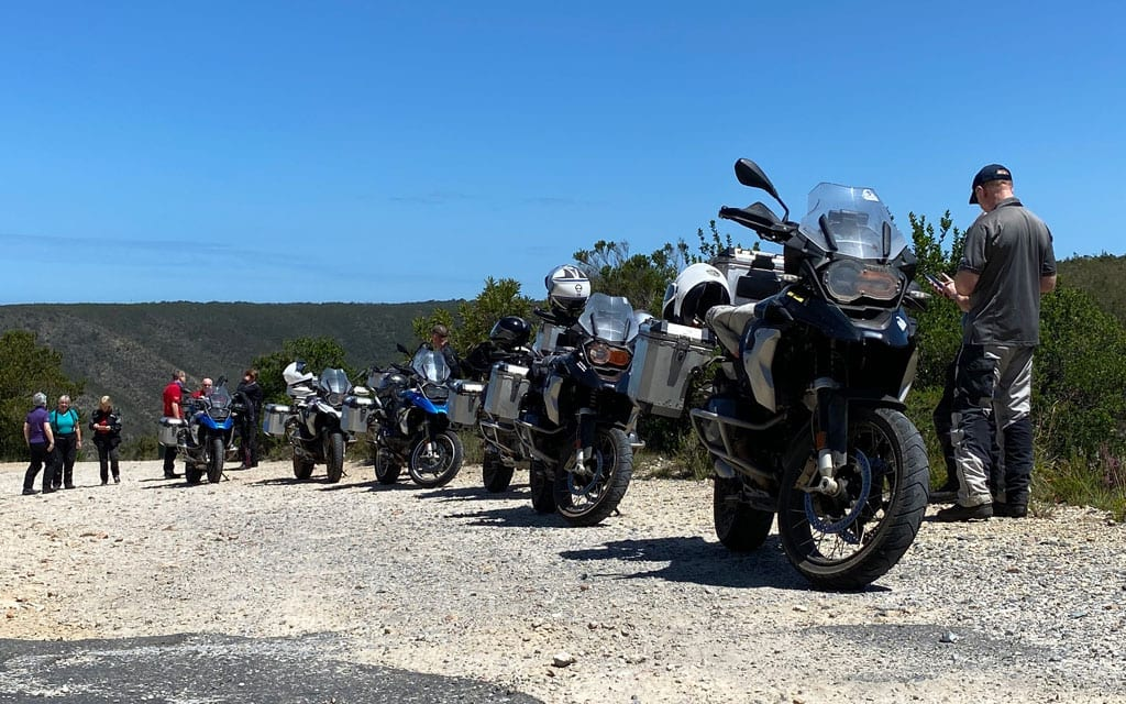 The group are parked up on the side of a gravel road.