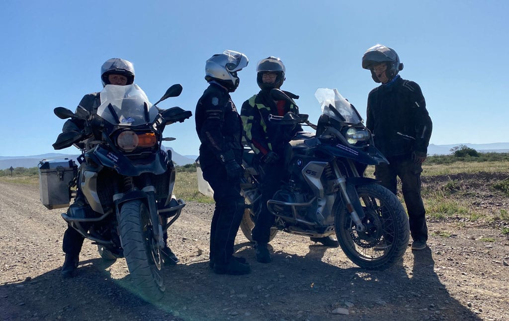 The group stop for a discussion along a straight road.